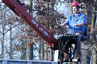 Richmond Arborist Brian Greene on a crane